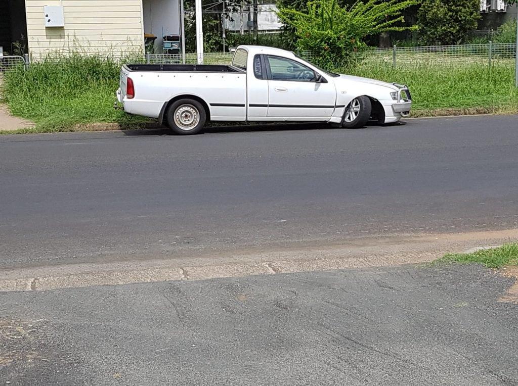 Broken ute waiting for transport
